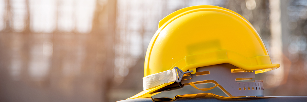 Yellow hard hat on a construction site
